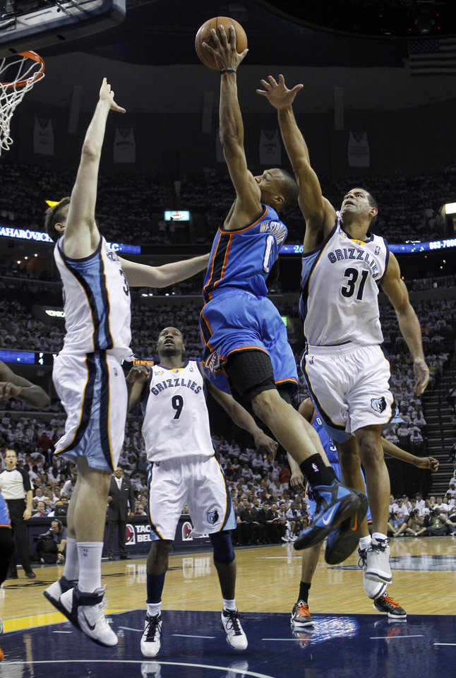 Oklahoma City Thunder guard Russell Westbrook (0) drives against Memphis Grizzlies defenders Marc Gasol, left, of Spain, Tony Allen (9) and Shane Battier (31) during the first half of Game 4 of a second-round NBA basketball playoff series on Monday, May 9, 2011, in Memphis, Tenn. (AP Photo/Lance Murphey)