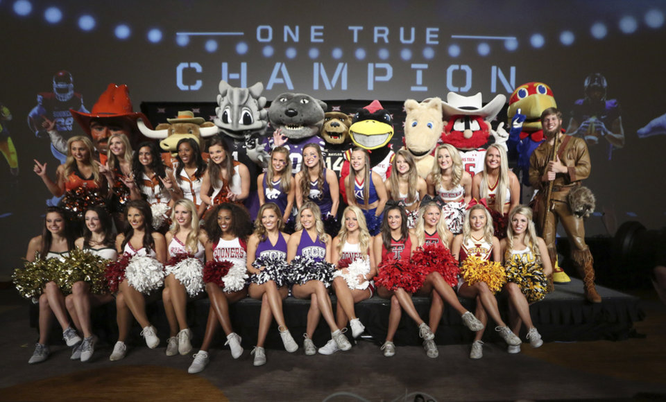 Photo - University cheerleaders and mascots poses for a photo on the main stage at the Big 12 Conference NCAA college football media days in Dallas, Tuesday, July 22, 2014. (AP Photo)