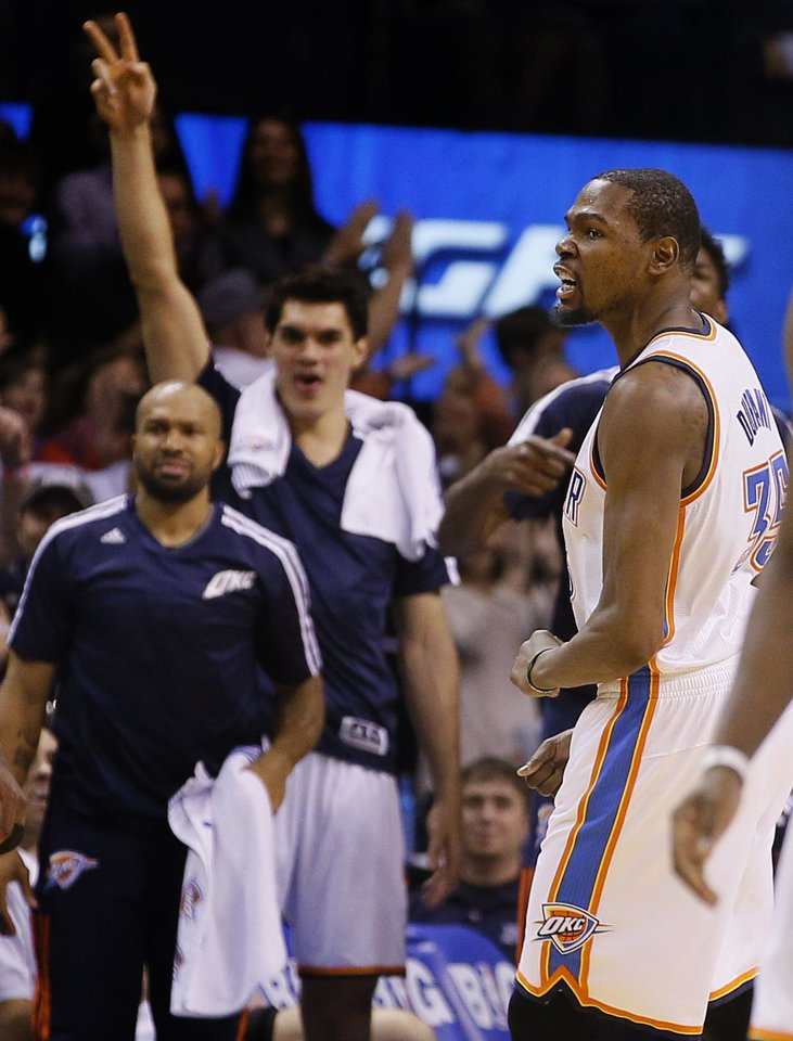 Photo - Oklahoma City's Kevin Durant (35) celebrates during an NBA basketball game between the Oklahoma City Thunder and the Golden State Warriors at Chesapeake Energy Arena in Oklahoma City, Saturday, Jan. 18, 2014. Oklahoma City won 127-121. Photo by Bryan Terry, The Oklahoman