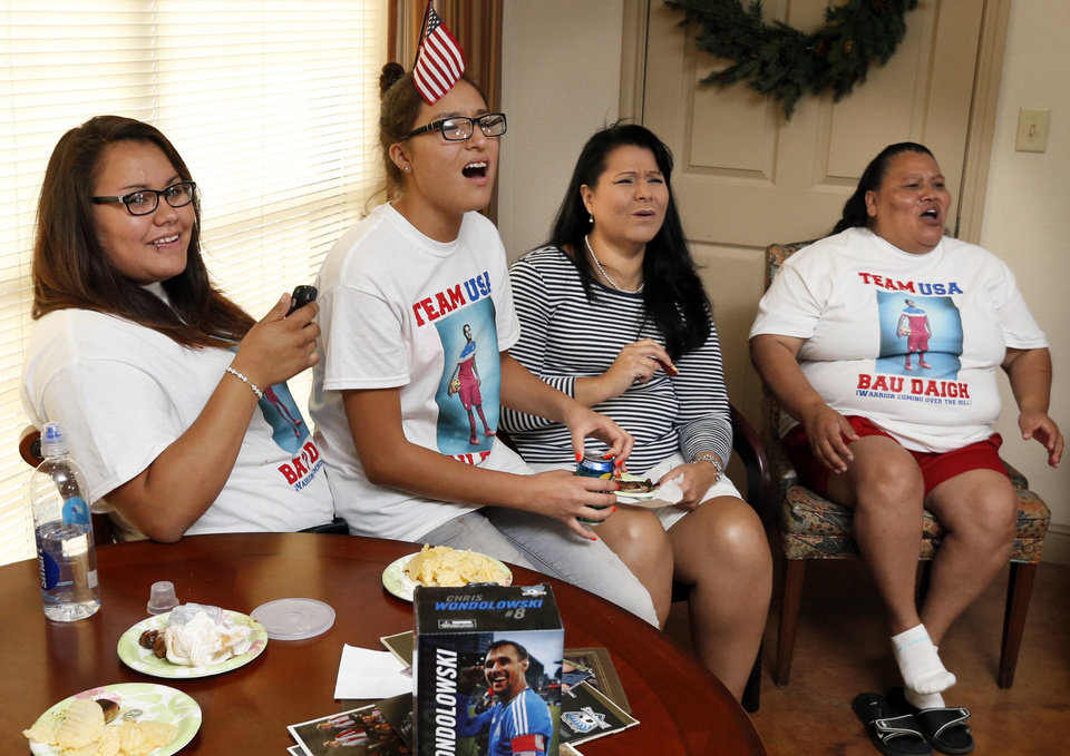 Photo -  Chelsea Dupoint,, Amy Cozad, Amy Cozad and Marla Quoetone watch family member Chris Wondolowski play against Germany for the American team in World Cup Soccer on Thursday in Lawton. Photo by Steve Sisney, The Oklahoman   STEVE SISNEY -  THE OKLAHOMAN