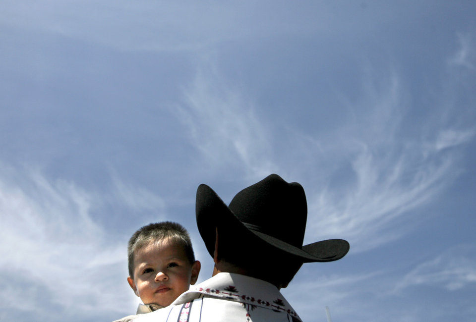 Antonio Gonzalez of Oklahoma City dances with his son Anthony, 1, during the Cinco De Mayo Festival at Plaza San Miguel in Oklahoma City Sunday, May 4, 2008. BY SARAH PHIPPS, THE OKLAHOMAN