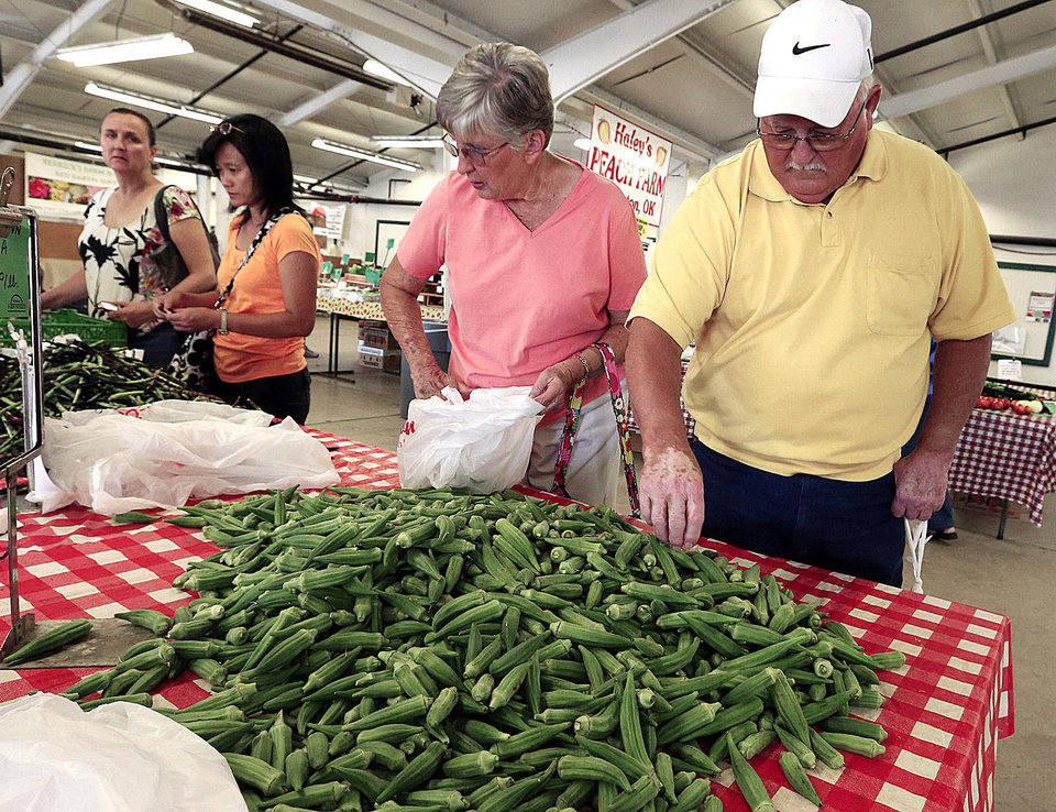 Photo - JOAN TURNER: Joan and Virgil Turner, Blanchard, buy okra at the Farmer's Market at the County Fairgrounds on Wednesday, Aug. 21, 2013 in Norman, Okla.  Photo by Steve Sisney, The Oklahoman