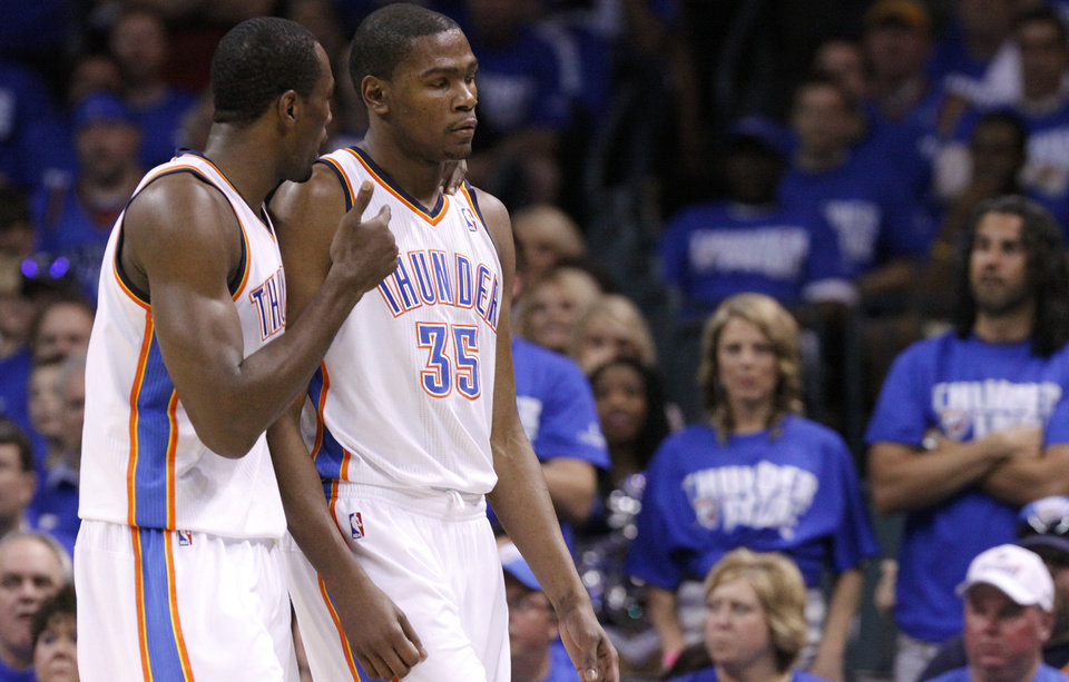 Oklahoma City\'s Serge Ibaka (9) talks with Oklahoma City\'s Kevin Durant (35) as the Thunder get off to a bad start against Dallas during game 3 of the Western Conference Finals of the NBA basketball playoffs between the Dallas Mavericks and the Oklahoma City Thunder at the OKC Arena in downtown Oklahoma City, Saturday, May 21, 2011. Photo by Chris Landsberger, The Oklahoman