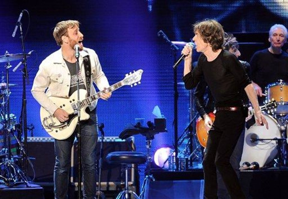 Photo - Guitarist Dan Auerbach of The Black Keys, left, and singer Mick Jagger of The Rolling Stones perform together at the Prudential Center in Newark, NJ on Saturday, Dec. 15, 2012. (Photo by Evan Agostini/Invision/AP)