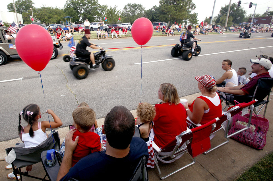 Photo - People watch the LibertyFest Parade in Edmond, Okla., Monday, July 4, 2011. Photo by Sarah Phipps, The Oklahoman