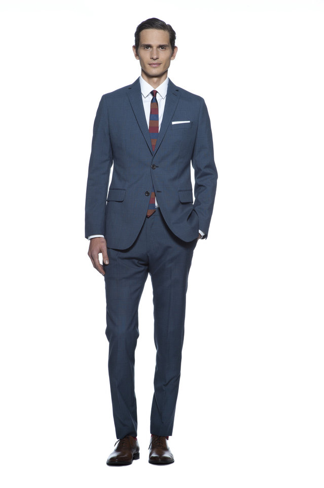 From Banana Republic's Mad Men spring 2013 collection, this slim fit suit is paired with a slim tie and pocket square. Photo provided. <strong>Greg Kessler</strong>