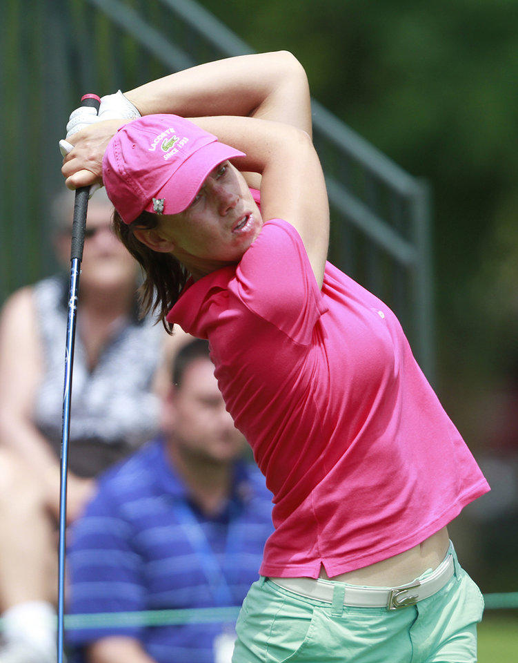 Photo -   Karine Icher tees off on the first hole during the third round of the Mobile Bay LPGA Classic golf tournament, Saturday, April 28, 2012, in Mobile, Ala. (AP Photo/Press-Register, Bill Starling) MAGS OUT