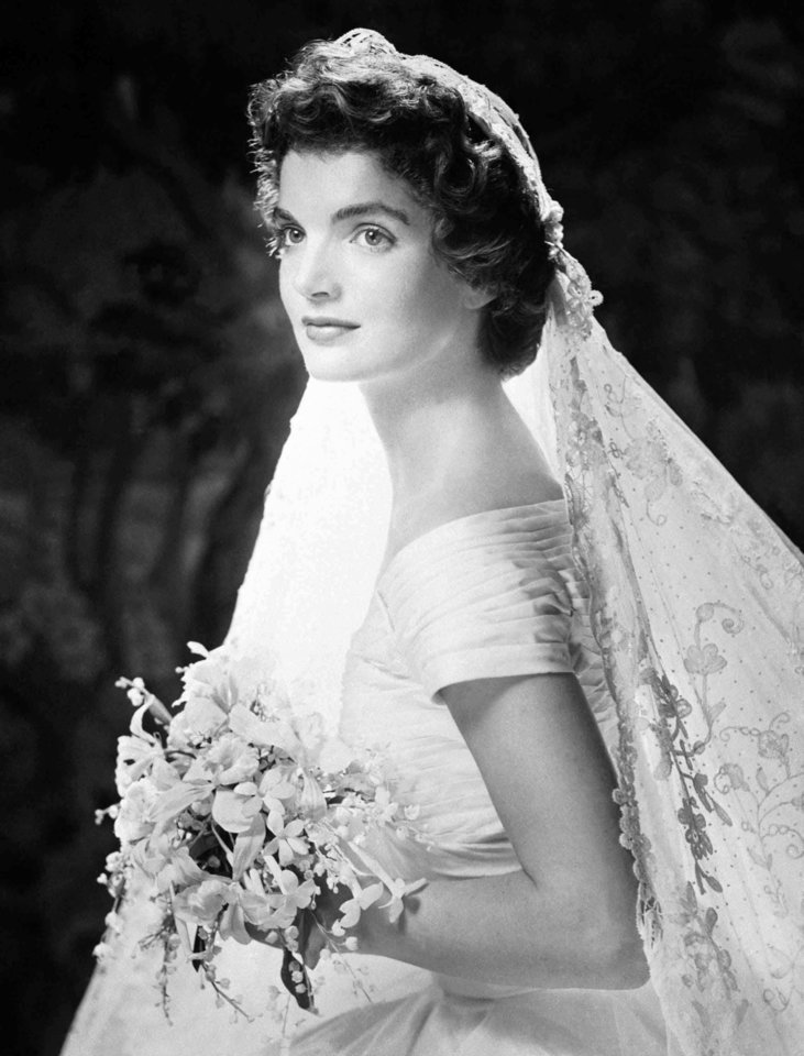 Photo - FILE-   This undate file photo shows Jacqueline Kennedy her wedding gown. Kennedy was