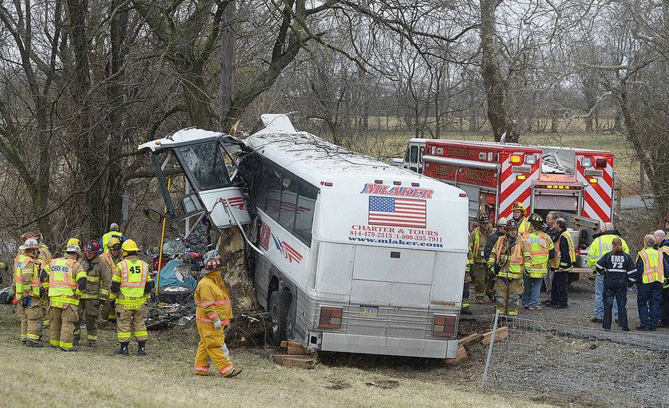 Photo - Emergency and rescue crews respond to the scene of a tour bus crash on the Pennsylvania Turnpike on Saturday, March 16, 2013 near Carlisle, Pa.  Authorities say the tour bus crashed on the freeway at mile marker 227 in central Pennsylvania, and serious injuries have been reported.  Lacrosse players from Seton Hill University and three coaches were among the 23 people aboard when the bus crashed at about 9 a.m., turnpike spokeswoman Renee Colborn said. It's not clear what caused the crash, but state police were investigating, said Megan Silverstram of the Cumberland County public safety department. (AP Photo/The Sentinel, Jason Malmont ) MANDATORY
