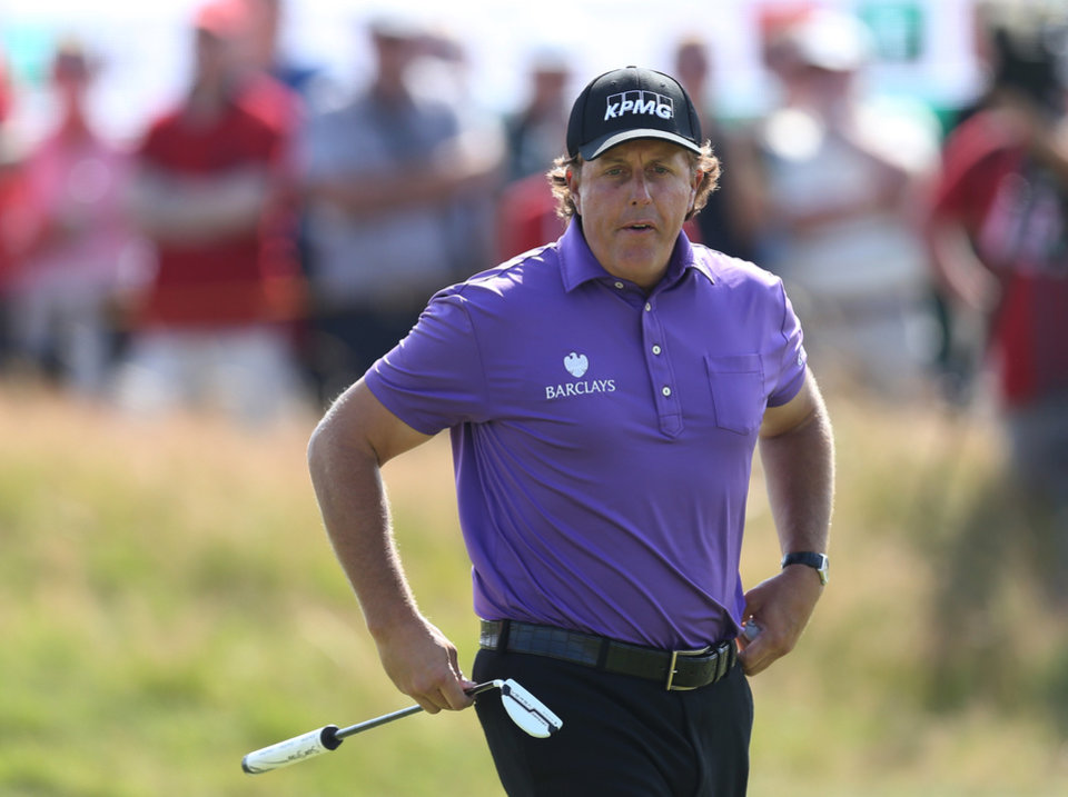 Photo - Phil Mickelson of the US prepares to putt on the 9th green during the first day of the British Open Golf championship at the Royal Liverpool golf club, Hoylake, England, Thursday July 17, 2014. (AP Photo/Scott Heppell)