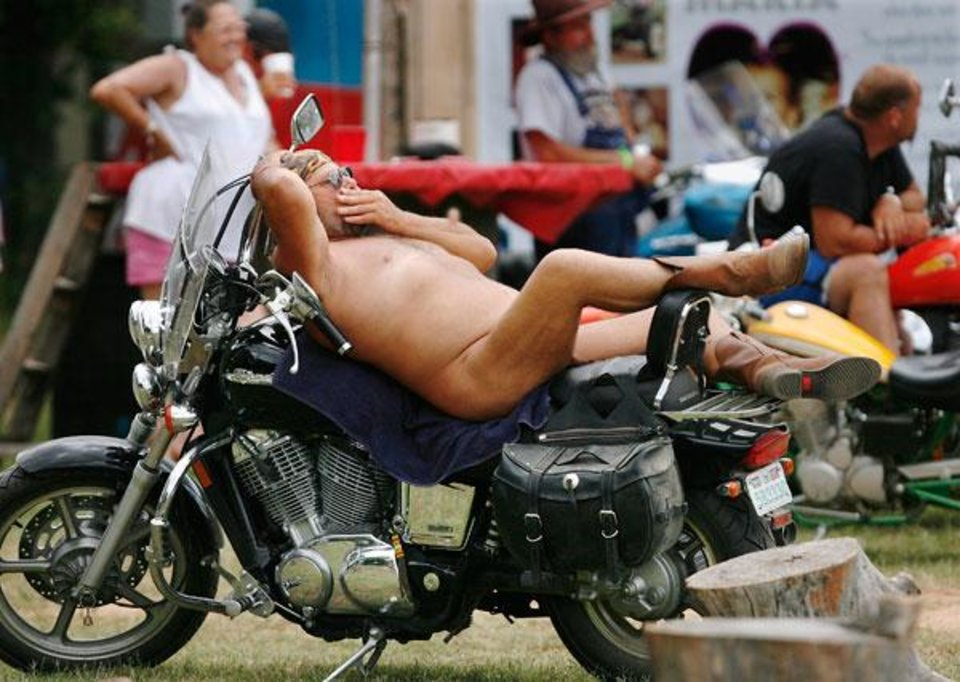 A man reclines on his motorcycle while waiting to participate in bike games at the Sparks America Bikers Week in Lincoln County June 19, 2009 . He is not identified, but people at the rally called him Nature Man.  Photo by Jim Beckel, The Oklahoman