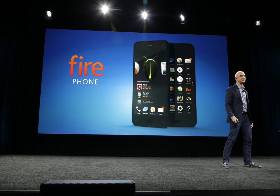 Photo - Amazon CEO Jeff Bezos introduces the new Amazon Fire Phone, Wednesday, June 18, 2014, in Seattle. (AP Photo/Ted S. Warren)