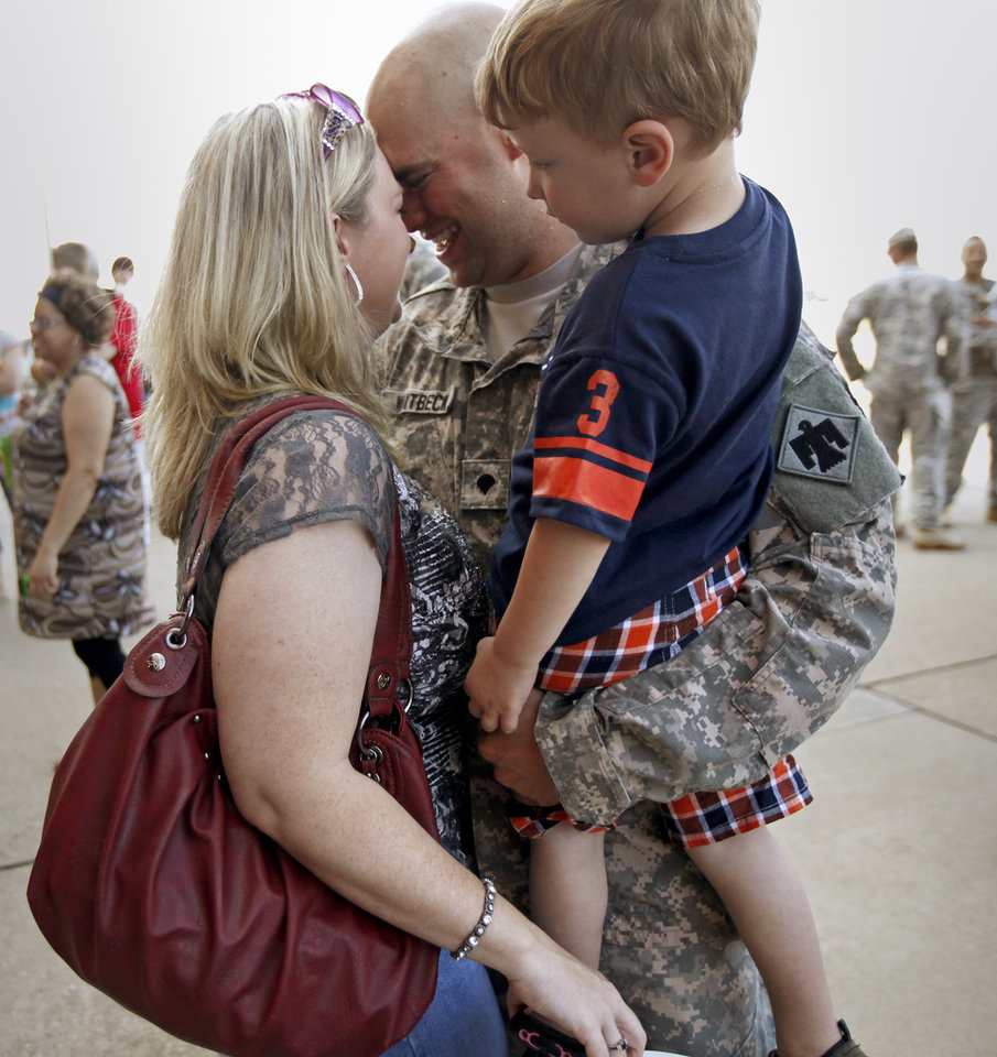 Spc. Blake Whitbeck greets his wife Hollie Whitbeck, and son Michael, 3, , after returning from Kuwait with the Oklahoma National Guard's 180th Cavalry Squadron at the Will Rogers Air National Guard Base in Oklahoma City, Saturday, March 31, 2012. A homecoming ceremony welcomed about 180 soldiers from the Oklahoma National Guard's 180th Cavalry Squadron returning from Kuwait along with members of the Oklahoma National Guard's 45th Infantry Brigade Combat Team returning from Afghanistan. Photo by Bryan Terry, The Oklahoman