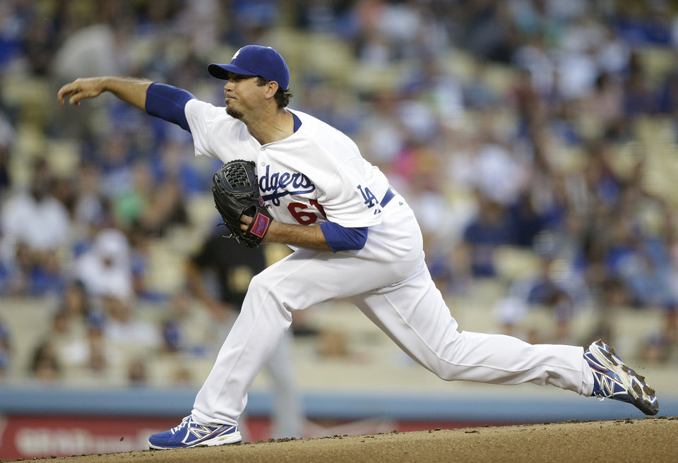 Photo - Los Angeles Dodgers starting pitcher Josh Beckett throws against the Pittsburgh Pirates during the second inning of a baseball game Friday, May 30, 2014, in Los Angeles. (AP Photo/Jae C. Hong)