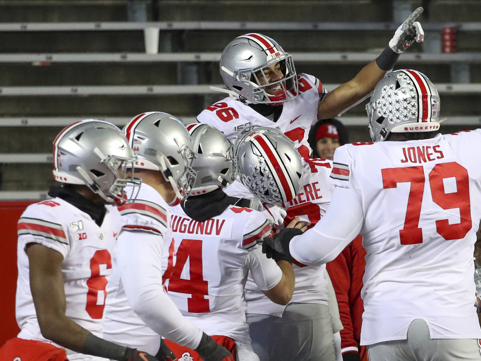 Photo - Ohio State wide receiver Jaelen Gill (26) celebrates his touchdown reception during the fourth quarter of an NCAA college football game against Rutgers on Saturday, Nov. 16, 2019 in Piscataway, N.J. Ohio State won 56-21. (Andrew Mills/NJ Advance Media via AP)