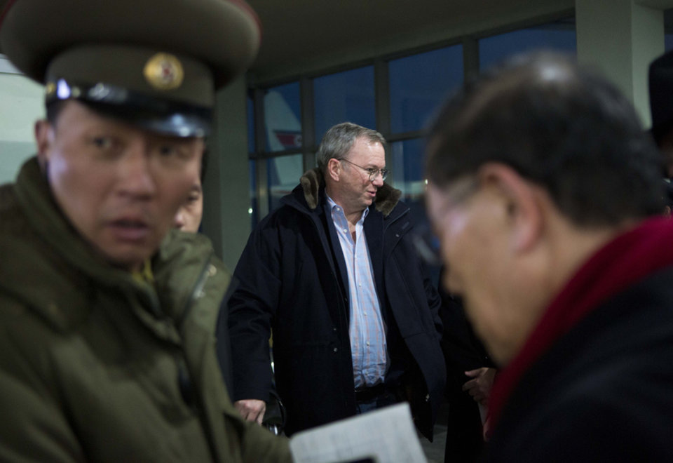 Photo - Executive Chairman of Google Eric Schmidt, center, arrives at Pyongyang International Airport in Pyongyang, North Korea on Monday, Jan. 7, 2013. Schmidt arrived in the North Korean capital along with former New Mexico Gov. Bill Richardson. Richardson called the trip to North Korea a private humanitarian visit. (AP Photo/David Guttenfelder)
