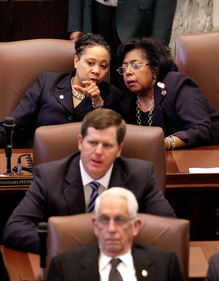 Photo - Rep. Anastasia Pittman, back row, left,  confers with Sen.  Judy Eason McIntyre while Gov. Mary Fallin delivers her 2012 State of the State address to a joint session of the Oklahoma legislature in the House Chamber on the opening day of the session, Monday, Feb, 6, 2012.   Photo by Jim Beckel, The Oklahoman