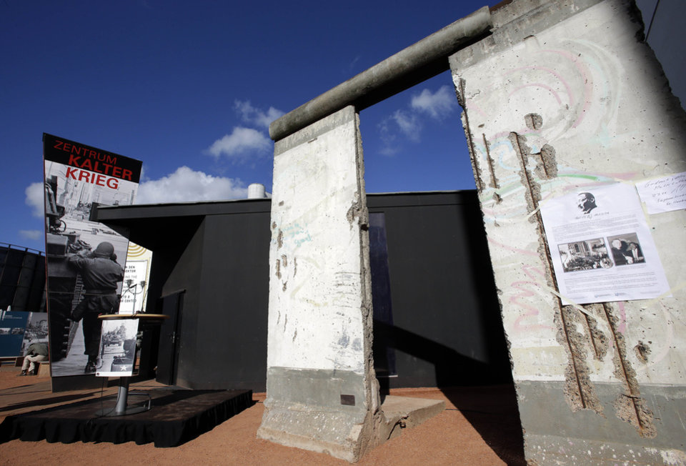 Photo -   Two pieces of the Berlin Wall are placed in front of the new cold war museum 'Black Box' at the Checkpoint Charlie in Berlin, Germany, Thursday, Sept. 20, 2012. (AP Photo/Michael Sohn)