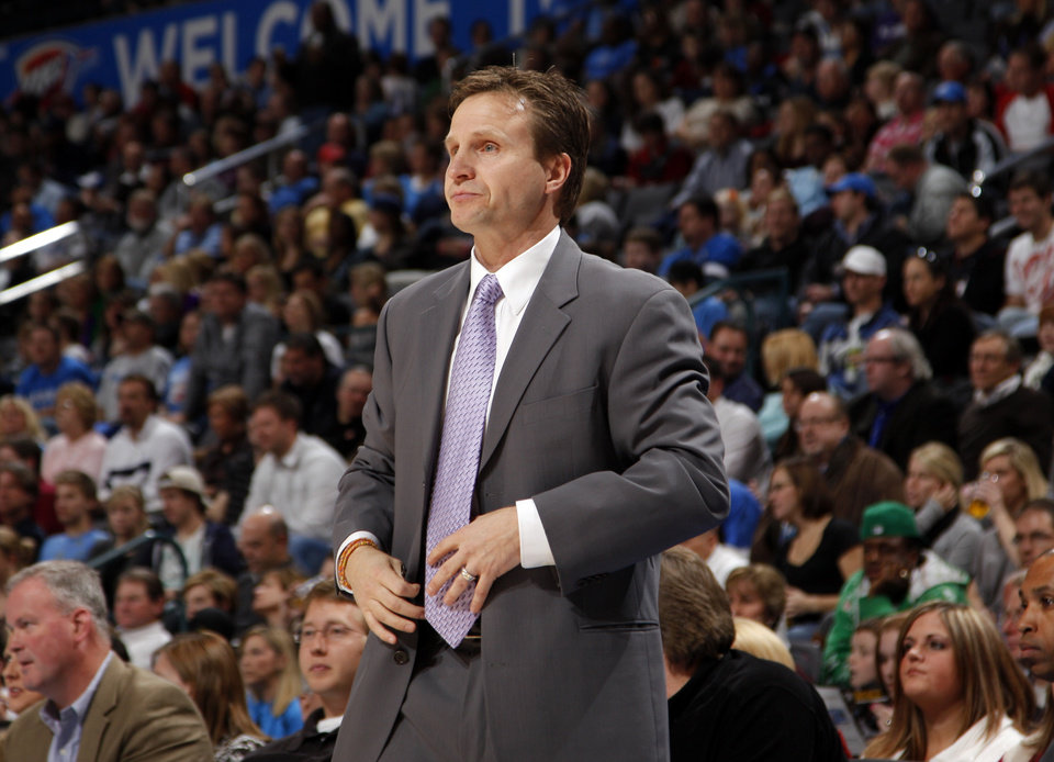 Photo - Oklahoma City head coach Scott Brooks watches game action during the NBA game between the Oklahoma City Thunder and the Miami Heat Sunday Jan. 18, 2009, at the Ford Center in Oklahoma City. PHOTO BY SARAH PHIPPS, THE OKLAHOMAN