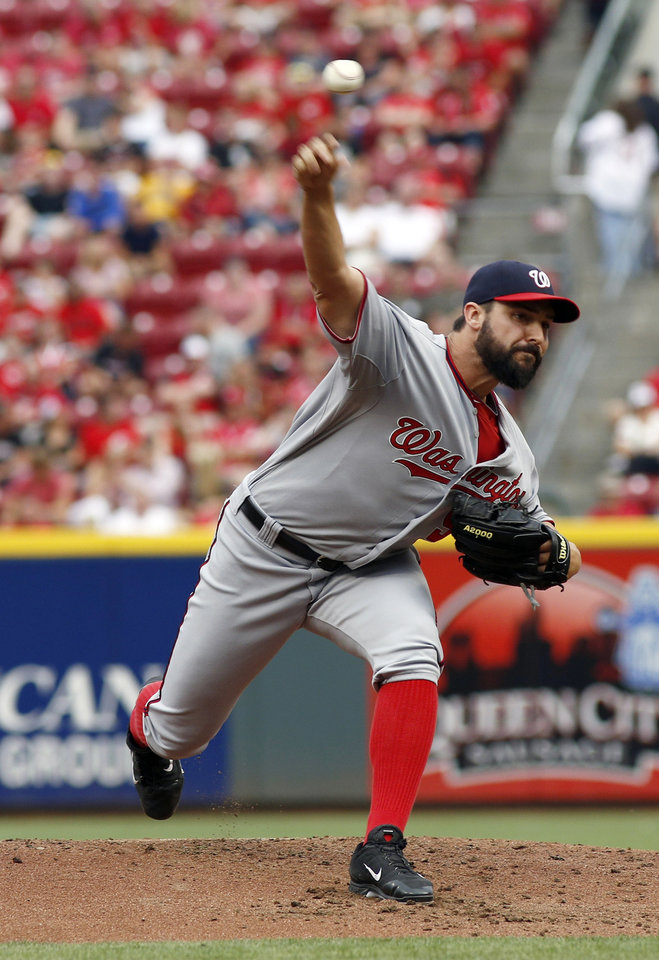 Photo - Washington Nationals starting pitcher Tanner Roark throws against the Cincinnati Reds in the first inning of a baseball game, Friday, July 25, 2014, in Cincinnati. (AP Photo/David Kohl)