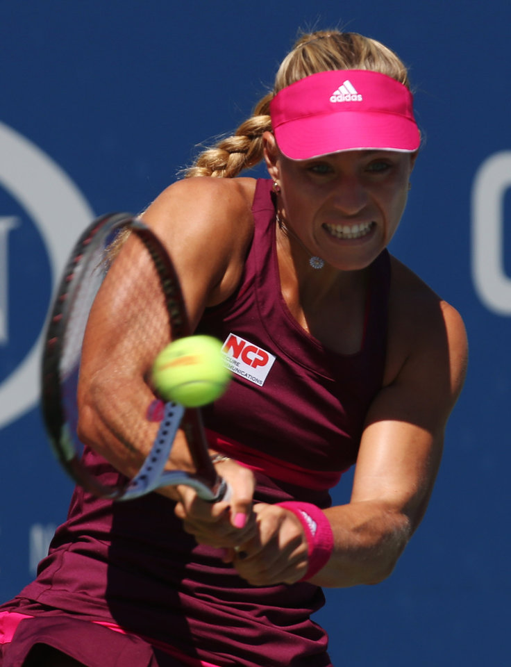 Photo - Angelique Kerber, of Germany, returns a shot against Belinda Bencic, of Switzerland, during the third round of the 2014 U.S. Open tennis tournament, Friday, Aug. 29, 2014, in New York. (AP Photo/John Minchillo)
