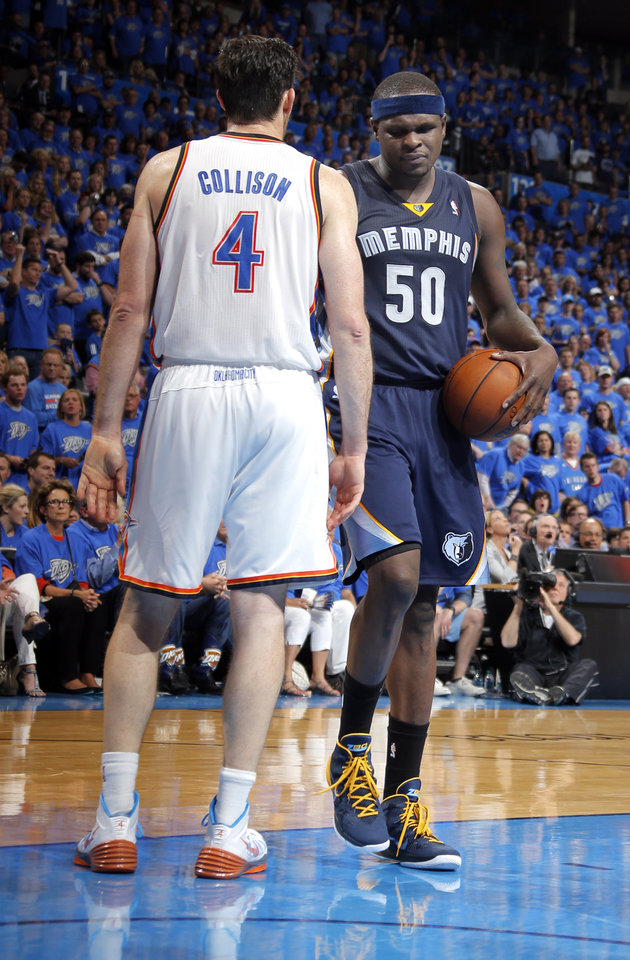 Photo - Memphis' Zach Randolph (50) walks by Oklahoma City's Nick Collison (4) after a fould during Game 1 in the first round of the NBA playoffs between the Oklahoma City Thunder and the Memphis Grizzlies at Chesapeake Energy Arena in Oklahoma City, Saturday, April 19, 2014. Photo by Sarah Phipps, The Oklahoman