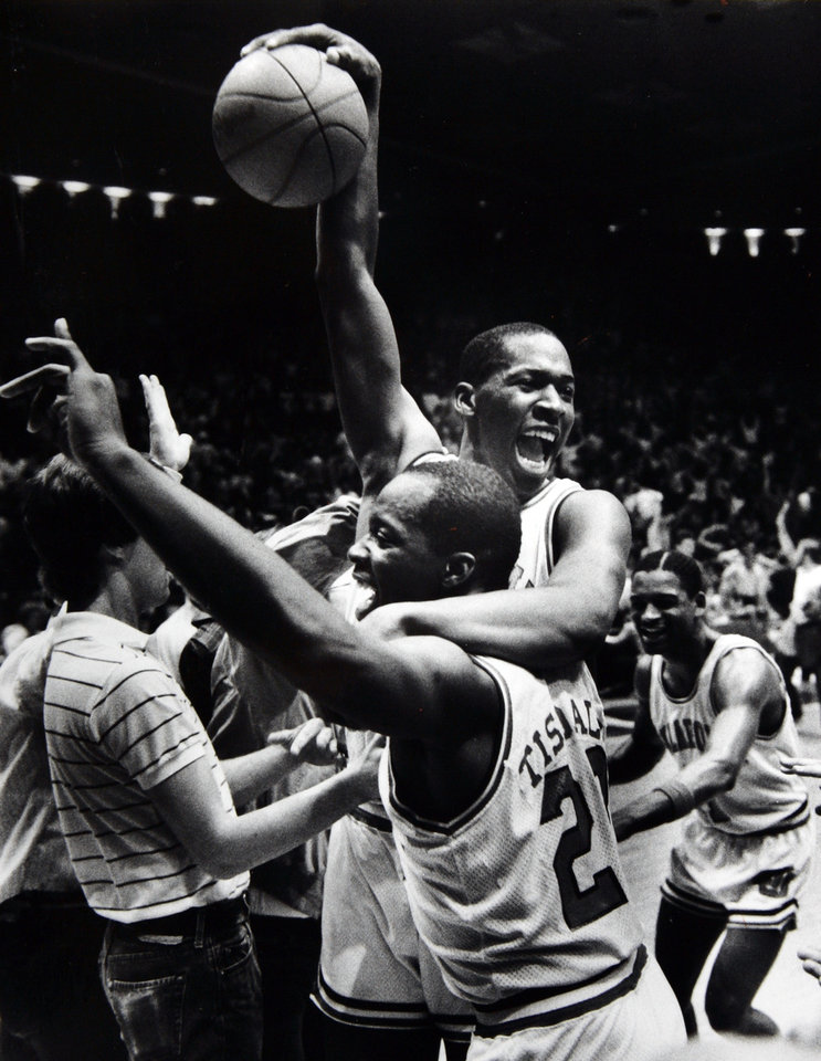 Photo - Former OU basketball player Wayman Tisdale. As usual Wayman Tisdale had a big hand in a Sooner victory. But brother William  (with Wayman) get an assist. OU held off UNLV 78-70 on Saturday. Staff Photo by Doug Hoke. Photo taken, published 3/4/1984 in The Daily Oklahoman. ORG XMIT: KOD