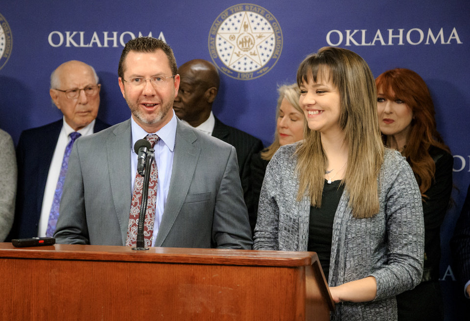 Photo -  Kris Steele and former inmate Kayla Jeffries speak Friday during the Oklahomans for Criminal Justice Reform news conference at the state Capitol. [Photo by Chris Landsberger, The Oklahoman]
