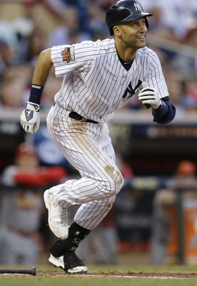 Photo - American League shortstop Derek Jeter, of the New York Yankees, singles during the third inning of the MLB All-Star baseball game, Tuesday, July 15, 2014, in Minneapolis. (AP Photo/Jeff Roberson)