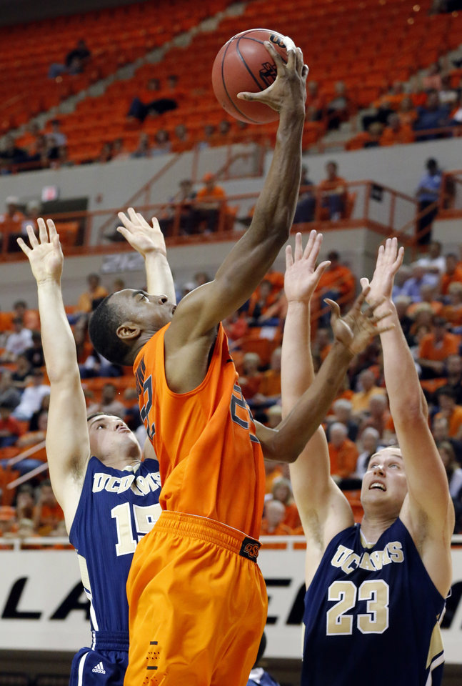 Oklahoma State's Markel Brown (22) shoots as UC Davis' Tyler Les (15) and Josh Ritchart (23) during the men's college basketball game between Oklahoma State and UC Davis at  Gallagher-Iba Arena in Stillwater, Okla., Friday, Nov. 9, 2012. Photo by Sarah Phipps, The Oklahoman