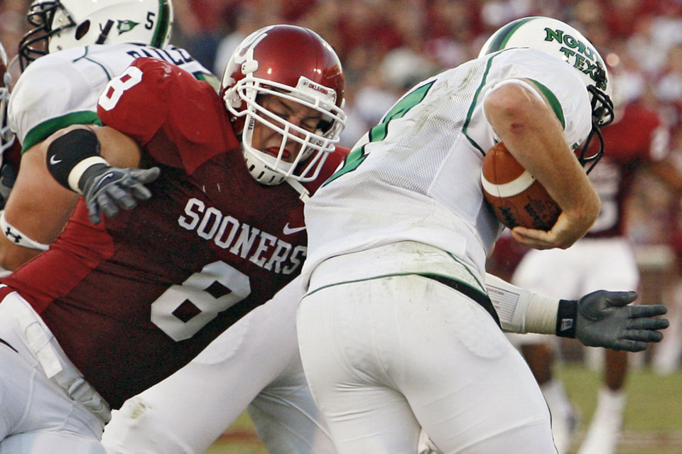 Photo - Oklahoma Ryan Reynolds (8) sacks North Texas quarterback Daniel Meager (7)  in the first half during the University of Oklahoma Sooners (OU) college football game against the University of North Texas Mean Green (UNT) at the Gaylord Family - Oklahoma Memorial Stadium, on Saturday, Sept. 1, 2007, in Norman, Okla.