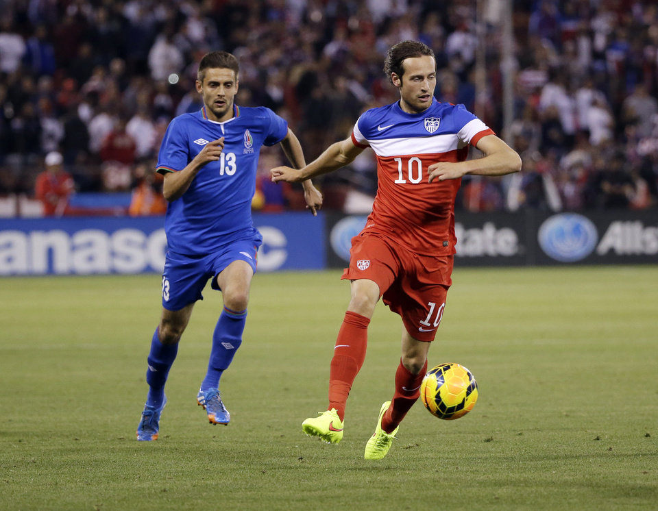 Photo - United States' Mix Diskerud, right, dribbles past Azerbaijan's Dimitrij Nazarov, left, during the second half of an international friendly soccer match on Tuesday, May 27, 2014, in San Francisco. United States won 2-0. (AP Photo/Marcio Jose Sanchez)