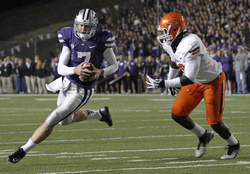 Kansas State's Collin Klein (7) runs past Oklahoma State's Calvin Barnett (99) during the college football game between the Oklahoma State University Cowboys (OSU) and the Kansas State University Wildcats (KSU) at Bill Snyder Family Football Stadium on Saturday, Nov. 1, 2012, in Manhattan, Kan. Photo by Chris Landsberger, The Oklahoman