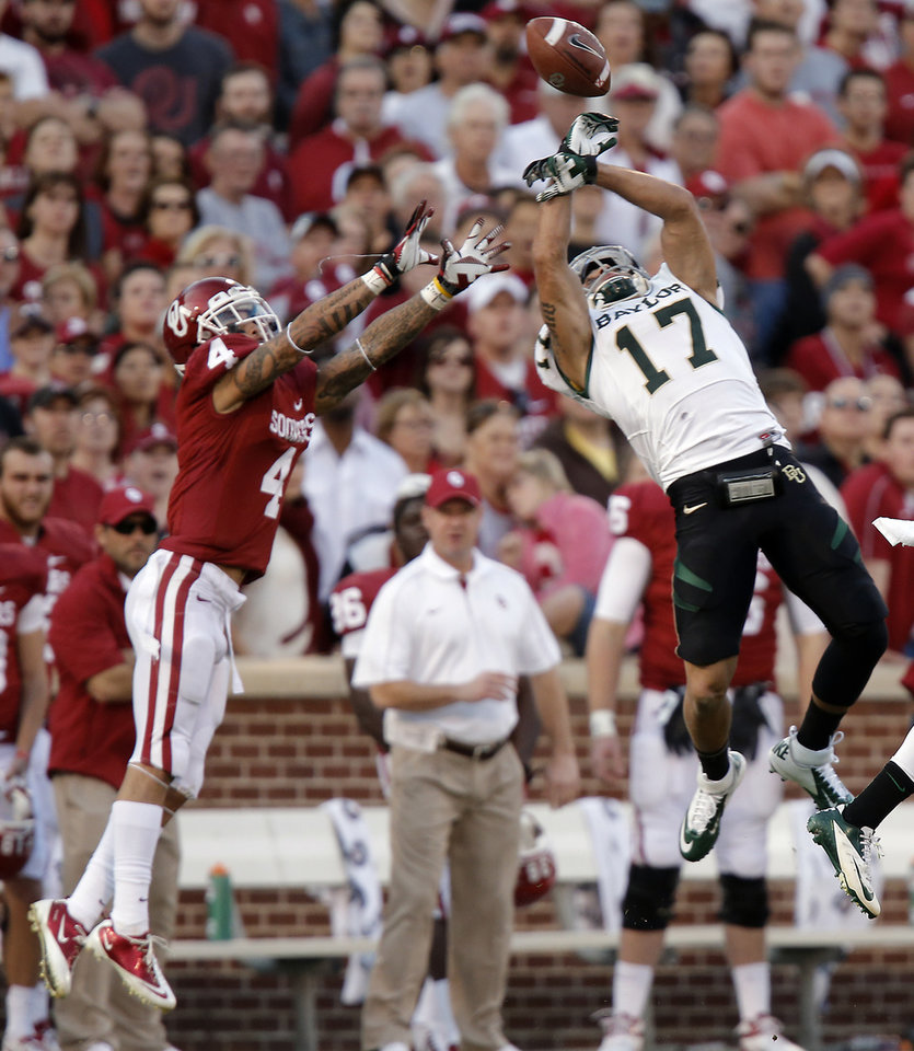 Baylor\'s Mike Hicks (17) makes an interception on a pass for Oklahoma\'s Kenny Stills (4) during the college football game between the University of Oklahoma Sooners (OU) and Baylor University Bears (BU) at Gaylord Family - Oklahoma Memorial Stadium on Saturday, Nov. 10, 2012, in Norman, Okla. Photo by Chris Landsberger, The Oklahoman