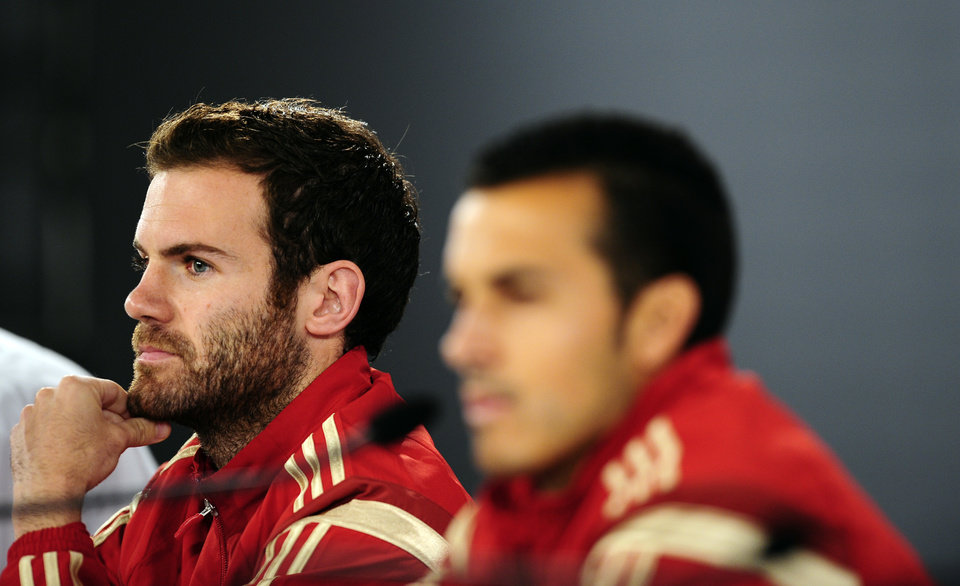 Photo - Spain's Pedro Rodriguez, right, and Juan Mata listen, during a press conference at the Atletico Paranaense training center in Curitiba, Brazil, Monday, June 16, 2014. Spain will play Chile in group B World Cup soccer match on Wednesday.  (AP Photo/Manu Fernandez)