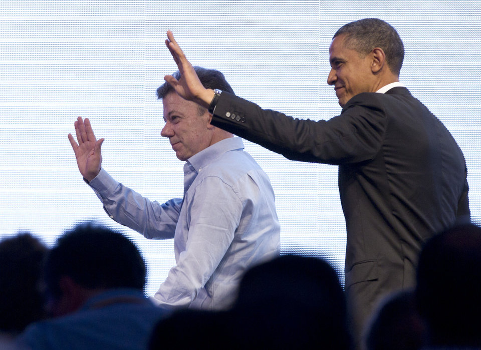 President Barack Obama and Colombia's President Juan Manuel Santos wave to the audience at the end of their three-way conversation that included Brazil's President Dilma Rousseff, not pictured, at the CEO Summit of the Americas in Cartagena, Colombia, Saturday April 14, 2012. Regional business leaders are meeting parallel to the sixth Summit of the Americas which brings together presidents and prime ministers from Canada, the Caribbean, Latin America and the U.S. (AP Photo/Carolyn Kaster)
