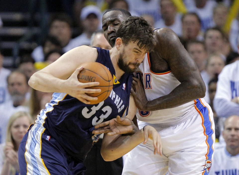 Photo - Oklahoma City's Kendrick Perkins (5) defends Marc Gasol (33) of Memphis during game five of the Western Conference semifinals between the Memphis Grizzlies and the Oklahoma City Thunder in the NBA basketball playoffs at Oklahoma City Arena in Oklahoma City, Wednesday, May 11, 2011. Photo by Sarah Phipps, The Oklahoman