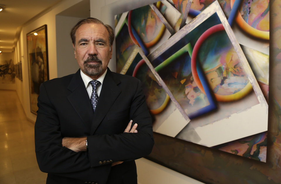 FILE- In this In this Dec. 11, 2013 file photo, developer and art collector Jorge Perez, poses for a photograph in his office at the Related Group, in Miami. Perez is one of Florida�s powerful Cuban-American business leaders. He wants to soften the U.S. government�s longtime economic embargo against Cuba�s communist government. (AP Photo/Lynne Sladky, File)