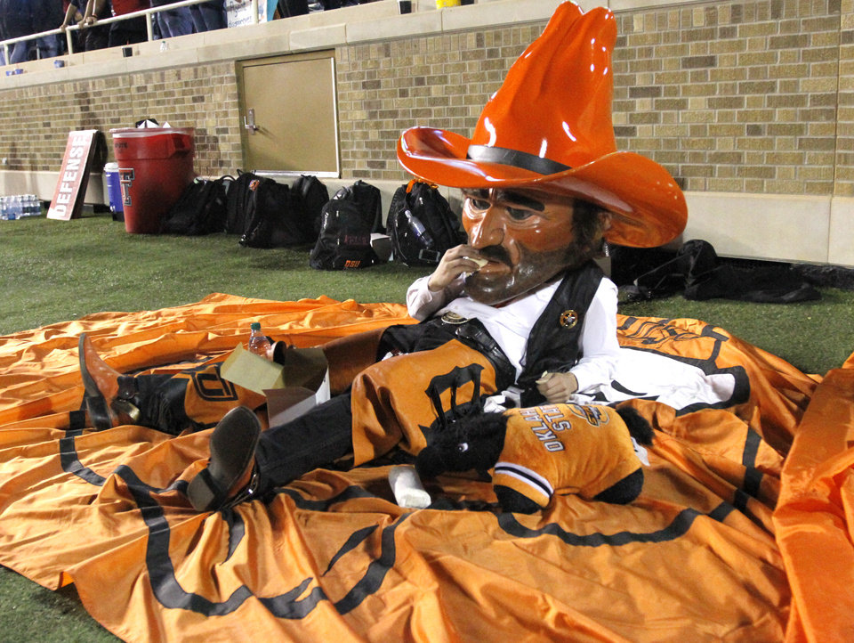 Pistol Pete eat a tortilla Texas Tech Fans threw on the field during the college football game between the Oklahoma State Cowboys (OSU) and the Texas Tech Red Raiders (TTU) at Jones AT&T Stadium in Lubbock, Texas, Saturday, Nov. 2, 2013. Photo by Sarah Phipps, The Oklahoman
