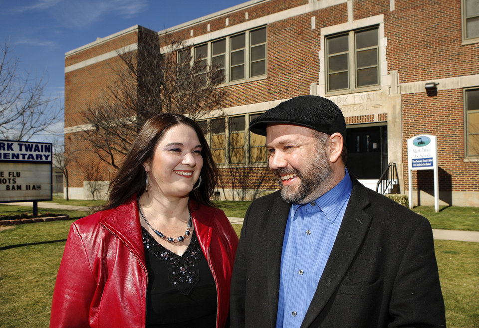 The Rev. Ernie Tullis and his wife, Terri, stand in front of Mark Twain Elementary School, 2451 W Main, where the couple met in grade school and they now hold Sunday church services in the school's gymnasium. Photo by Jim Beckel, The Oklahoman . <strong>Jim Beckel</strong>