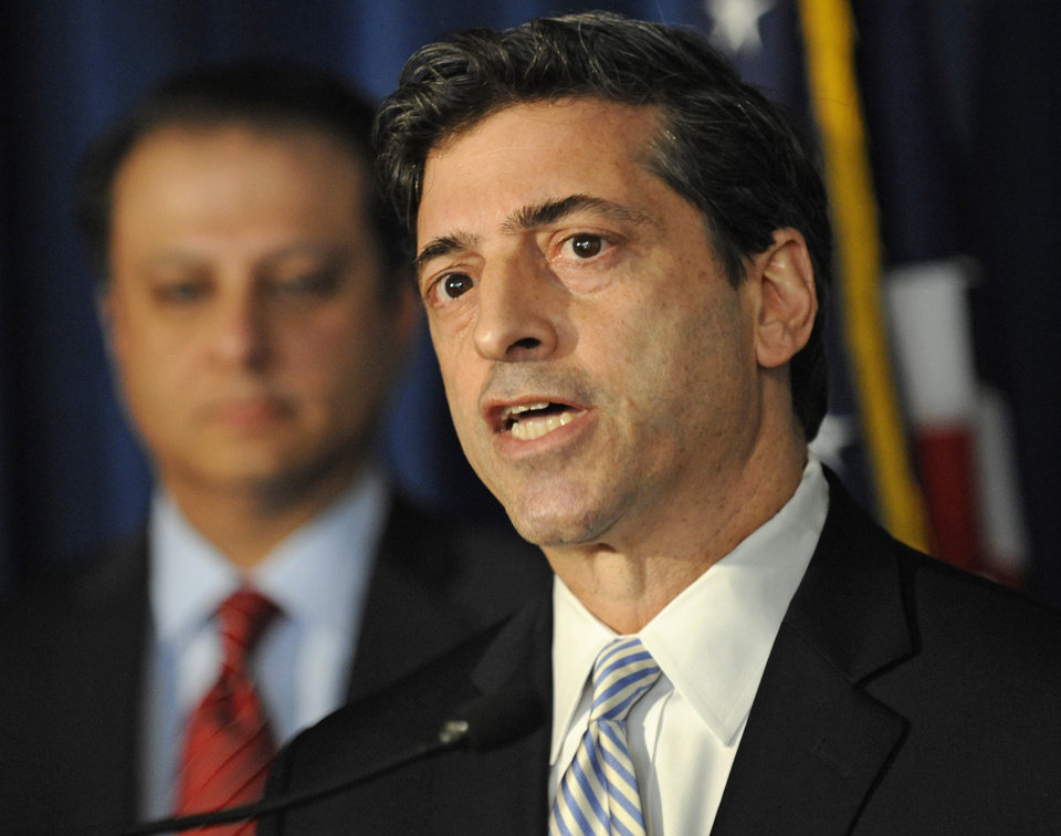 CORRECTS NAME OF SPEAKER- U. S. Attorney for the Southern district of N.Y. Preet Bharara, left, looks on as Robert Khuzami, director of the SEC division of enforcement speaks at a news conference, Tuesday, Nov. 20, 2012, in New York. Mathew Martoma, a former hedge fund portfolio manager was arrested Tuesday on charges that he helped carry out the most lucrative insider trading scheme in U.S. history, nabling investment advisers and their hedge funds to make more than $276 million in illegal profits. (AP Photo/Louis Lanzano)