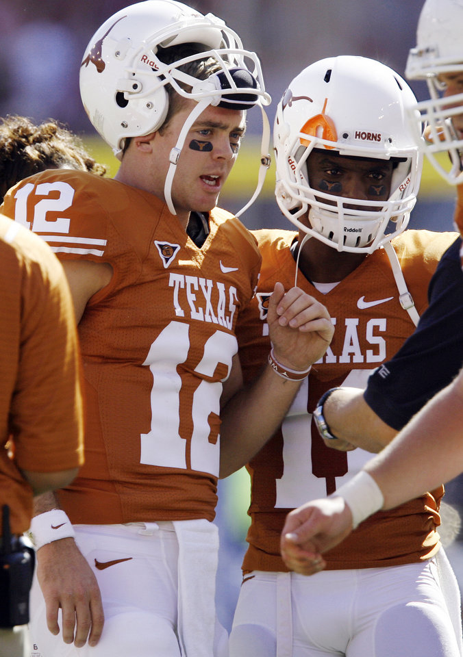 Photo - Texas' quarterback Colt McCoy (12) talks to teammate James Kirkendoll (11) during the Red River Rivalry college football game between the University of Oklahoma Sooners (OU) and the University of Texas Longhorns (UT) at the Cotton Bowl in Dallas, Texas, Saturday, Oct. 17, 2009. Photo by Chris Landsberger, The Oklahoman