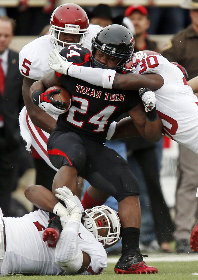 Oklahoma\'s Javon Harris (30), right, and Corey Nelson (7), lower left, stop Texas Tech\'s Eric Stephens Jr. (24) during a college football game between the University of Oklahoma (OU) and Texas Tech University at Jones AT&T Stadium in Lubbock, Texas, Saturday, Oct. 6, 2012. OU won, 41-20. Photo by Nate Billings, The Oklahoman