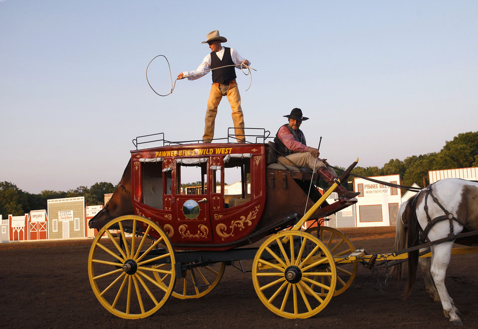 Photo - Richard Heinrich entertains the crowd June 23 by performing on the roof of a stagecoach during the Pawnee Bill Wild West Show in Pawnee. The season's last performance is  Saturday night. See story on State, back page. Photos by Jim Beckel, The Oklahoman