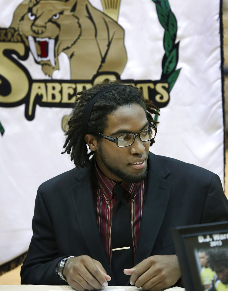 D. J. Ward, after he signed a letter of intent to play football at the University of Oklahoma. More than a dozen Southmoore High School athletes signed letters of intent to play at various colleges and universities during an afternoon signing ceremony in the school\'s gymnasium on Wednesday, Feb. 6, 2013. Photo by Jim Beckel, The Oklahoman