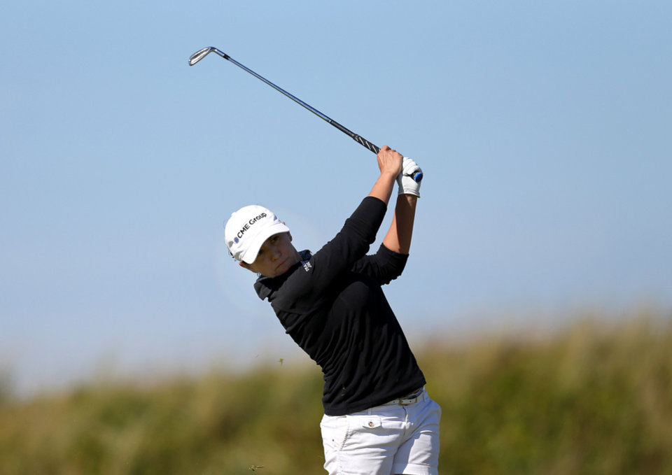Photo - Mo Martin of the US plays a shot on the 9th fairway during the second day of the Women's British Open golf championship on the Royal Birkdale Golf Club, Southport, England, Friday July 11, 2014. (AP Photo/Scott Heppell)