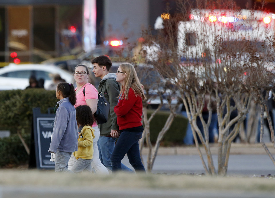 Photo - People leave the south side of Penn Square Mall after a shooting inside the mall in Oklahoma City, Thursday, Dec. 19, 2019. [Nate Billings/The Oklahoman]
