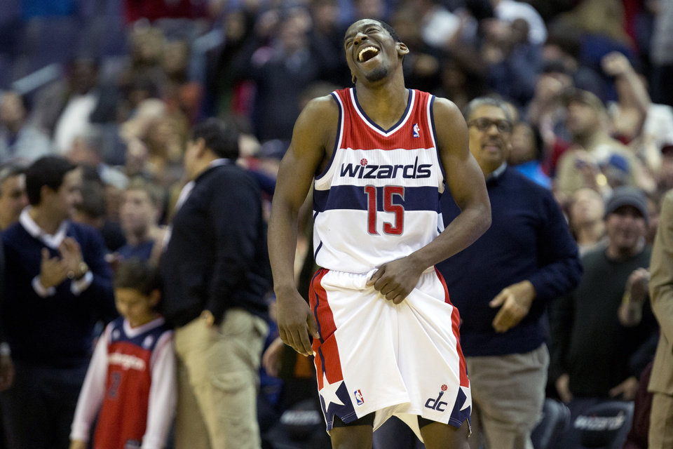Washington Wizards shooting guard Jordan Crawford (15) laughs in the final seconds of an NBA basketball game as Washington defeated the Orlando Magic at the Verizon Center in Washington, Friday, Dec. 28, 2012. Washington won 105-97. (AP Photo/Jacquelyn Martin)