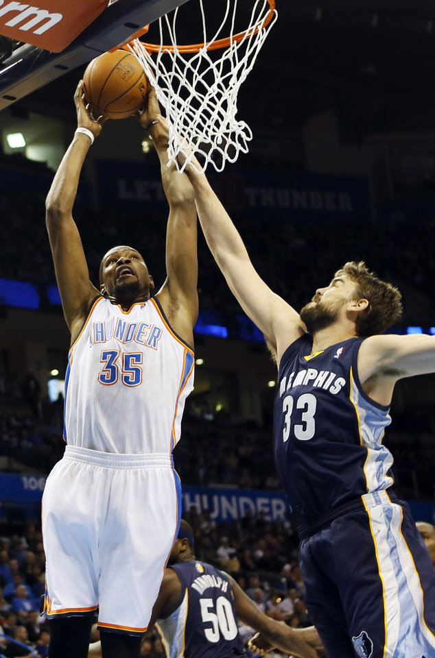 Oklahoma City\'s Kevin Durant (35) takes the ball to the hoop against Memphis\' Marc Gasol (33) in the first half during an NBA basketball game between the Oklahoma City Thunder and the Memphis Grizzlies at Chesapeake Energy Arena in Oklahoma City, Monday, Feb. 3, 2014. Photo by Nate Billings, The Oklahoman