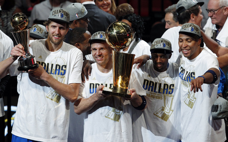 Dallas Mavericks' Dirk Nowitzki, left to right, Jason Kidd, Jason Terry and Shawn Marion celebrate after Game 6 of the NBA Finals basketball game against the Miami Heat Sunday, June 12, 2011, in Miami. The Mavericks won 105-95 to win the series. (AP Photo/Wilfredo Lee)  ORG XMIT: AAA212